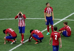 Atletico players react in despair after Ronaldo's penalty.