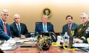 Donald Trump is joined in the White House situation room by, from left, the national security adviser, Robert O'Brien, Vice-President Mike Pence, secretary of defense, Mark Esper, and chairman of the joint chiefs of staff Gen Mark Milley.