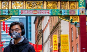 A member of the Chinese community in Manchester wearing a face mask.
