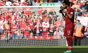 Mohamed Salah celebrates after being awarded the golden boot award.