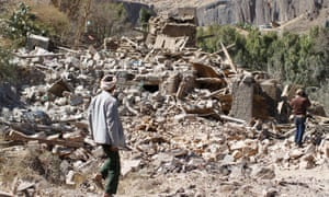 People walk on the rubble of a house destroyed by a Saudi-led air strike in Sanaa, Yemen