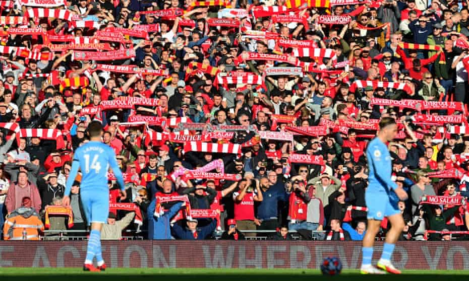 Liverpool fans warm up for the Manchester City game on 3 October.