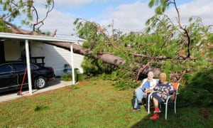 Clint and Brenda Canterbury outside their trailer home in Marianna, Florida, which was hit by Hurricane Michael.