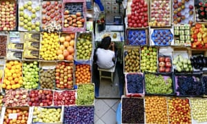 Kazan, Russia A boy takes a meal break at a fruit stall in the central market
