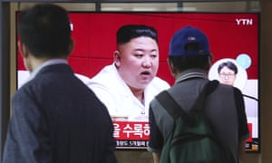 Kim Jong-un on a TV at Seoul station on Friday after he apologised for the killing of a South Korea official.