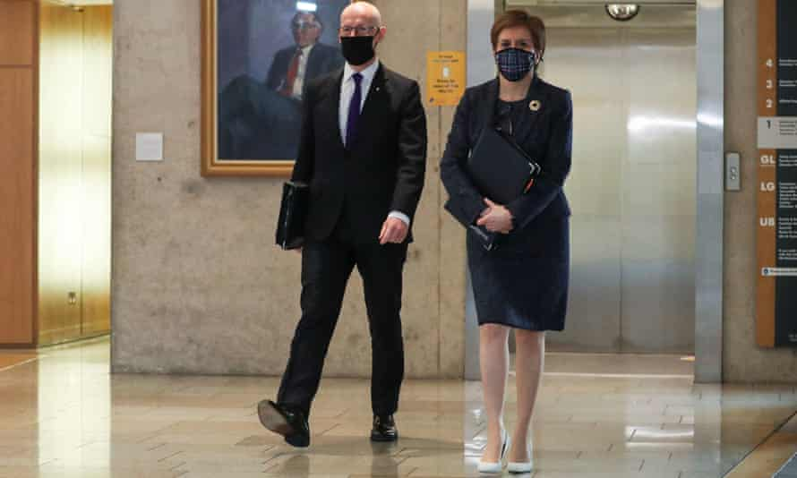 Nicola Sturgeon and John Swinney arrive for first minister's questions at Holyrood.