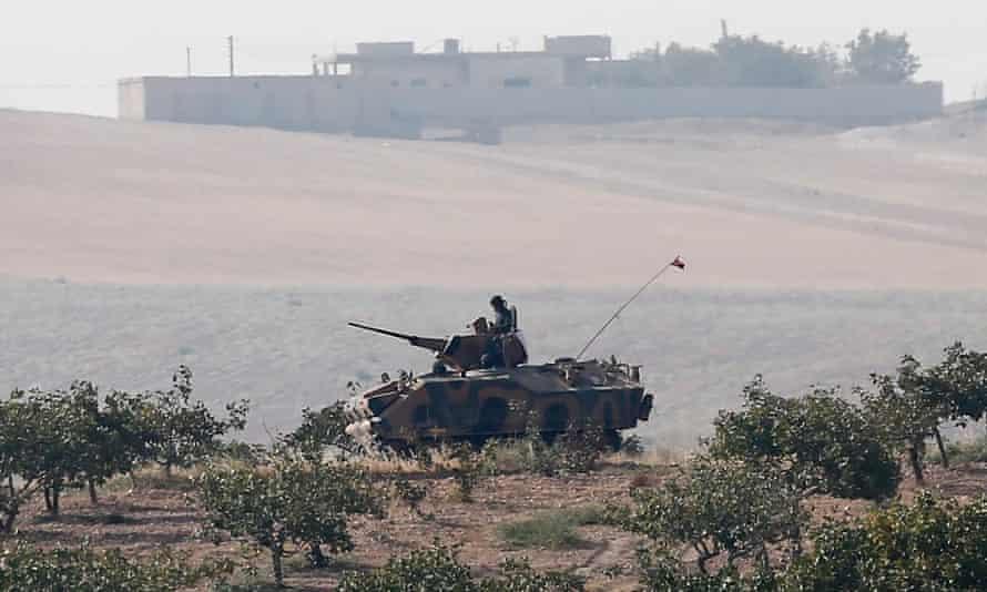 A Turkish armoured vehicle patrols near the Turkish-Syria border.