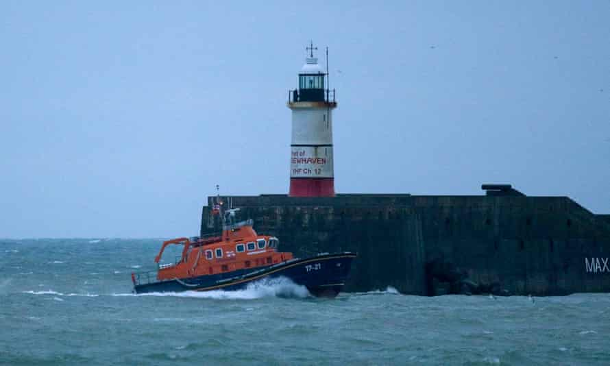 A RNLI lifeboat heads to Newhaven harbour, England.