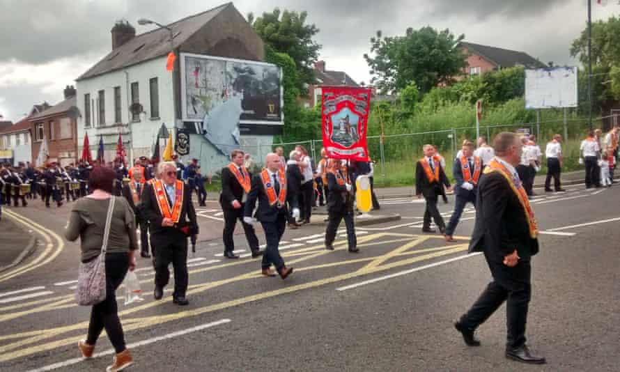 DUP voters cheer an Orange Order parade as it passed Carrickerfergus Castle