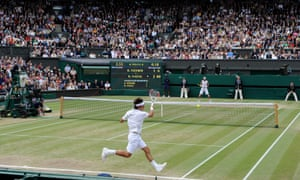 Roger Federer plays a running forehand in the first set.