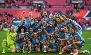 The Manchester City team pose with the trophy after they won beat Birmingham in a one-sided Women's FA Cup final.