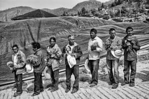 Men of the community of San Rafael offer flowers during the burial of Rafaela Sanchez. San Rafael, Guerrero. 2018