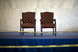 Chairs for heads of state are cordoned off with security tape in the secretariat building.