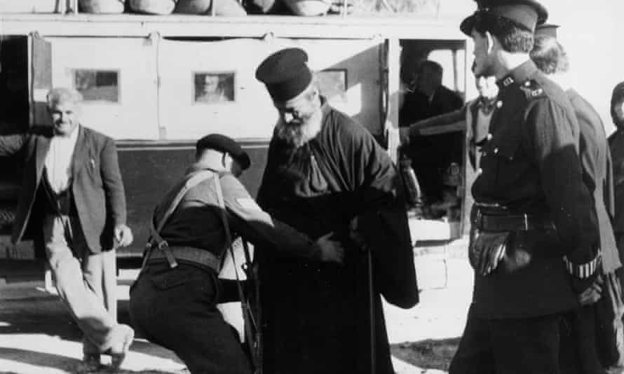 British soldiers search a Greek Orthodox priest in 1955.