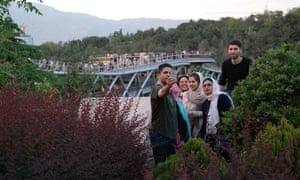 A family takes a selfie on Tabiat pedestrian bridge