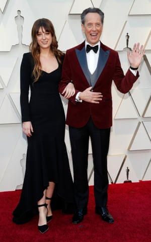 Richard E Grant wore red velvet tux jacket with clashing lapels. The actor, who was nominated for Best Supporting Actor for his role in Can You Ever Forgive Me?, was joined by his daughter Olivia, who wore a long-sleeve black dress