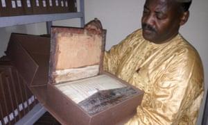 Abdel Kader Haidara showing rescued manuscripts in Bamako in 2015.