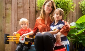 Elle Cavatore poses her boys, Thomas, left, and Patrick at their home in Houston, Texas.