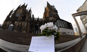 "A letter outside the Cologne Cathedral that says 'One doesn't beat women, not even with flowers"" was one of the tributes posted following New Year's Eve sex attacks in the city."