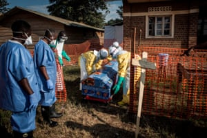 Medical workers disinfect a coffin at an Ebola treatment centre in Beni