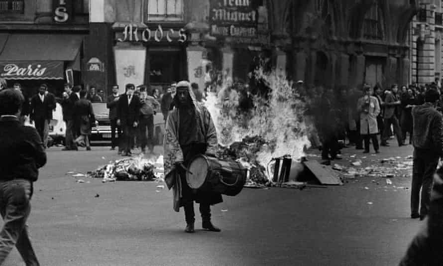 Tear gas silhouettes students May 23, 1968 on Boulevard Saint-Michel in Paris' Latin quarter.