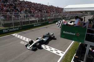 Hamilton takes the chequered flag.