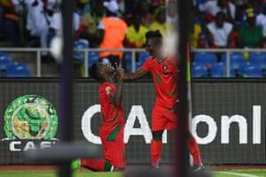 Guinea-Bissau's defender Juary Soares, left, celebrates after notching the equaliser.