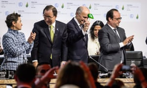 World leaders and UN officials agree on a global climate deal in Paris earlier this month.