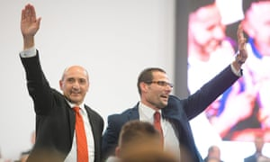 Robert Abela, right, and Chris Fearne wave to a crowd