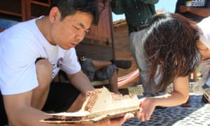 Jiang Hui, whose mother disappeared on board the Malaysia Airlines flight, examines a potential piece of debris.