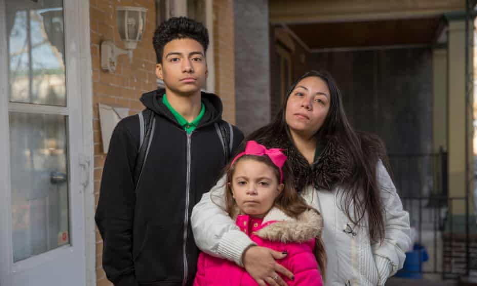 Rosa Trent with her children, Angel Hernandez and Marissa Trent on their porch in Camden, New Jersey