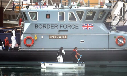 Border Force officers in a small rowing boat that was towed to Dover after being used by a group of men thought to be migrants, 16 June 2020.