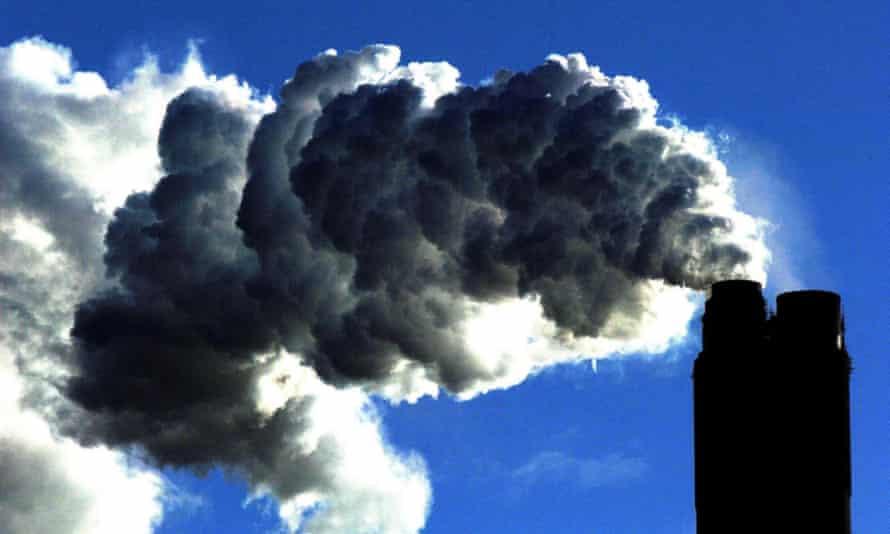 A coal plant pumps fumes into the sky