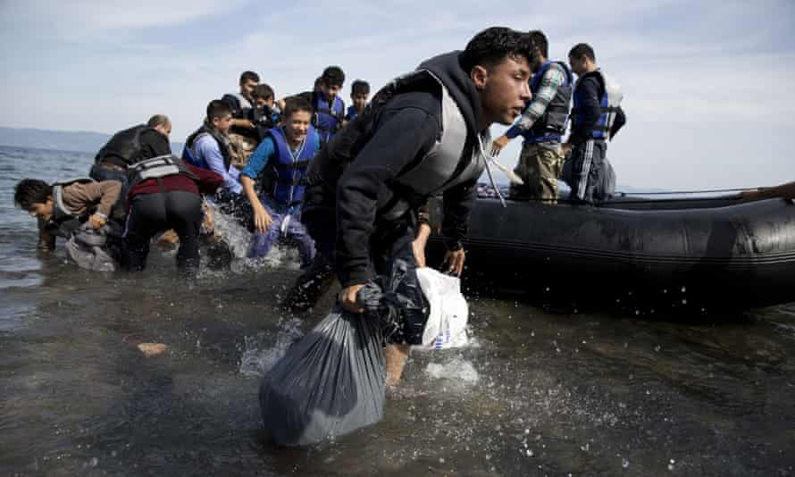 Afghan people arrive on the shores of the Greek island of Lesbos.