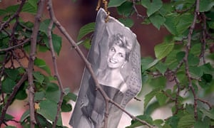 A newspaper cutting bearing messages hangs from a tree outside Diana's residence at Kensington Palace, days after she died on 31 August 1997