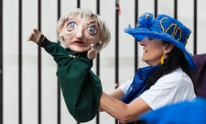 An anti-Brexit protester holds up a puppet of Theresa May