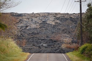 Lava covers a road on the outskirts of Pahoa.