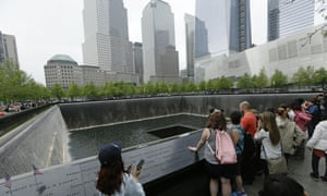 FILE - In this May 15, 2014, file photo, patrons visit the pools at The 9/11 Memorial near the World Trade Center in New York. Fifteen years after the Sept. 11th attacks, downtown New York has been reborn, not just with the construction of One World Trade, but with a host of attractions both somber and vibrant, including the 9/11 Memorial and Museum, two retail malls, new hotels and restaurants. (AP Photo/Frank Franklin II, File)