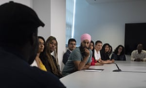 New Democratic Party leader Jagmeet Singh listens to people tell their stories about racism during a campaign stop in Toronto in September.