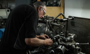 An employee of the Morgan Motor Company in Malvern, Worcestershire.
