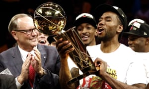 Kawhi Leonard holds up the Larry O'Brien Trophy after the Raptors clinched their first NBA title