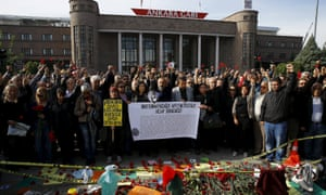 People attend a commemoration for the victims of the 10 October bombings in Ankara, Turkey