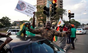 People celebrate the resignation of Zimbabwe's president Robert Mugabe, Harare, November 2017