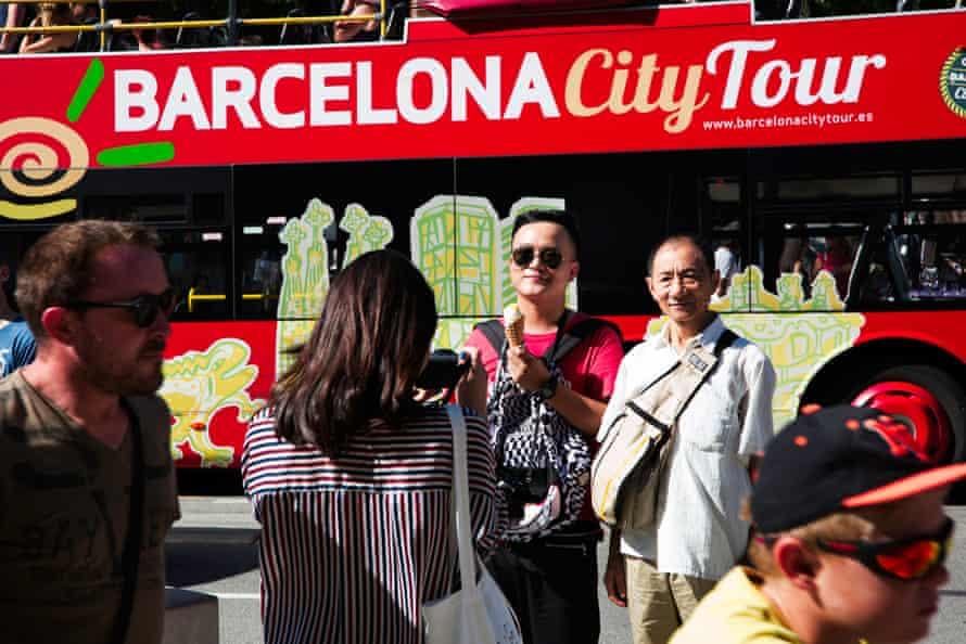 Tourists posing for snaps outside Sagrada Familia.
