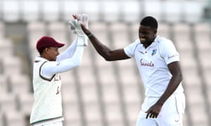 Jason Holder celebrates with wicketkeeper Shane Dowrich after taking the wicket of Ben Stokes