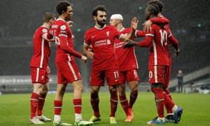 Liverpool players congratulate Saido Mane after he scores the third goal.