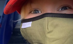"""A boy wears a face mask on a bus during the coronavirus crisis"""