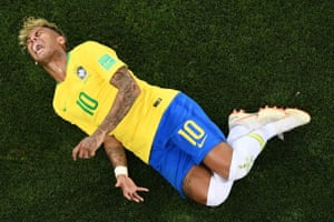 Brazil's forward Neymar reacts after a tackle at the World Cup