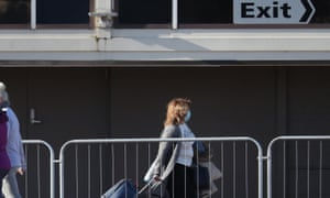 A guest leaves the Radisson Blu Edwardian hotel, near Heathrow Airport, London, after completing their 10-day stay at the Government-designated quarantine hotel.