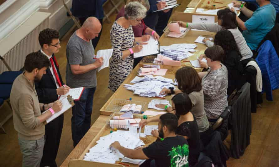 Counting staff sort ballot papers at in the Guildhall in Cambridge during the 2017 general election.